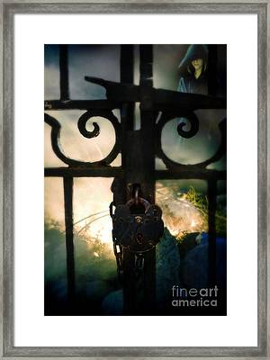 Hooded Figure By A Fire Framed Print