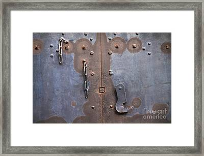 Hooked And Chained Framed Print by Dan Holm