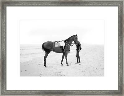 Horse And Man On The Beach Black And White Framed Print by Kittipan Boonsopit