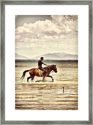 Framed Print featuring the photograph Horse Riding by Okan YILMAZ