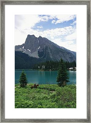 Horseback Riding Around Emerald Lake Framed Print by Michael Melford
