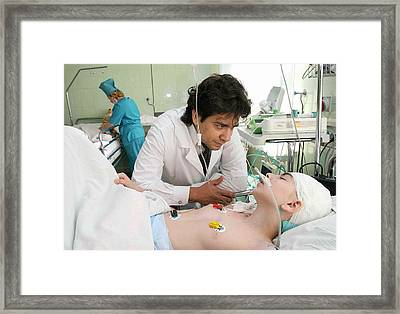Hospital Care For Beslan Schoolchildren Framed Print by Ria Novosti