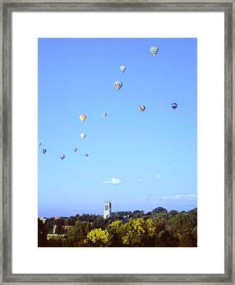 Hot Air Balloons Over Omaha Framed Print by John Bowers