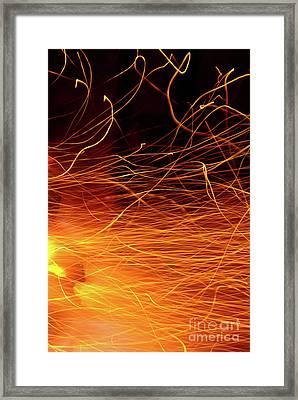 Hot Sparks Framed Print by Carlos Caetano