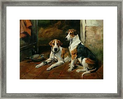 Hounds In A Stable Interior Framed Print by John Emms
