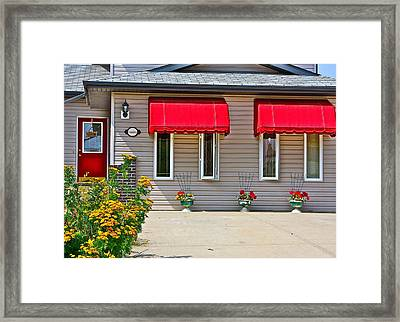House With Red Shades. Framed Print