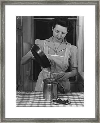 Housewife Pouring Waste Fats That Framed Print by Everett