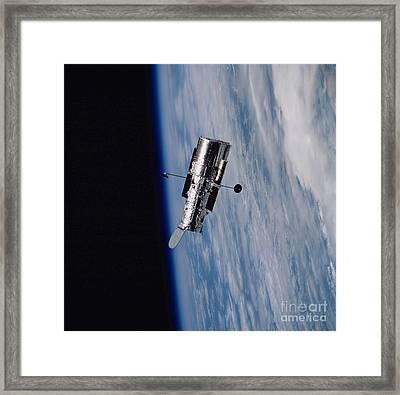 Hubble Space Telescope Backdropped Framed Print by Stocktrek Images