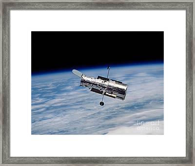 Hubble Space Telescope In Orbit Framed Print by Stocktrek Images