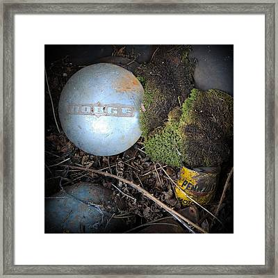 Hubcaps And Oil Cans Framed Print by Steve McKinzie