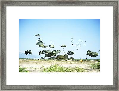 Humanitarian Aid Is Airdopped Framed Print