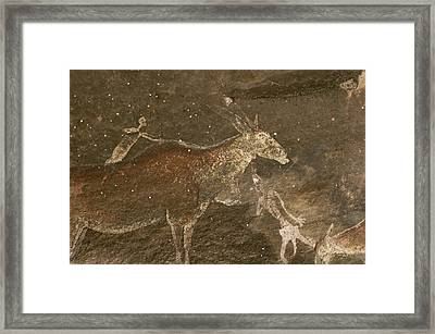 Hunters And Animals In A Cave Painting Framed Print by Kenneth Garrett