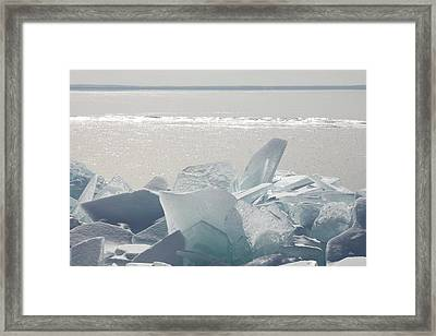 Ice Chunks On The Shores Of Lake Framed Print by Susan Dykstra