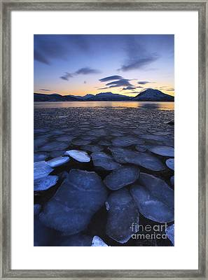 Ice Flakes Drifting Towards Framed Print by Arild Heitmann