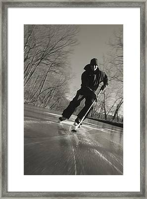 Ice Skater With A Hockey Stick Framed Print by Skip Brown