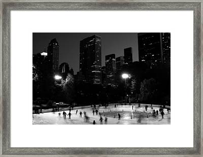 Ice Skating In Central Park Framed Print by Michael Dorn