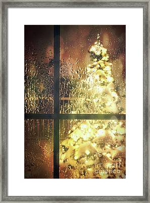 Icy Window With Holiday Tree Full Of Lights Framed Print by Sandra Cunningham