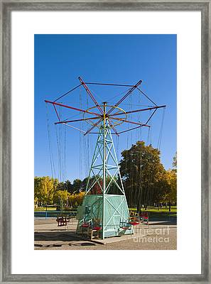 Idle Childrens Ride Framed Print by Thom Gourley/Flatbread Images, LLC