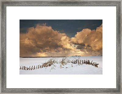 Illuminated Clouds Glowing Above A Framed Print by John Short