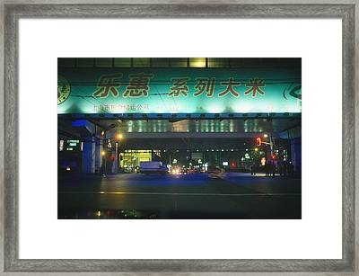 Illuminated Signs Brighten  A Shanghai Framed Print by Justin Guariglia