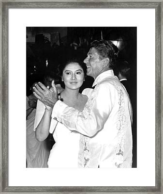Imelda Marcos Dancing With Ronald Reagan Framed Print by Everett