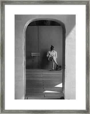 In The Doorway Framed Print by Robert Ullmann