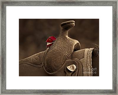 In The Saddle Framed Print