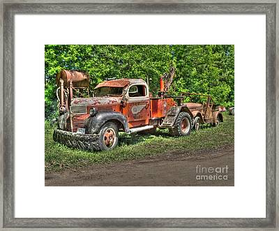 In Tow Framed Print by Jimmy Ostgard