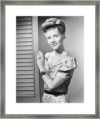 Indoor Portrait Of Woman In Door Way Framed Print by George Marks