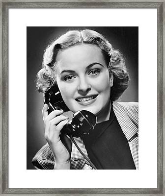 Indoor Portrait Of Woman On Telephone Framed Print by George Marks