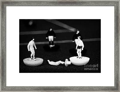 Injured Player Football Soccer Scene Reinacted With Subbuteo Table Top Football Players Game Framed Print by Joe Fox