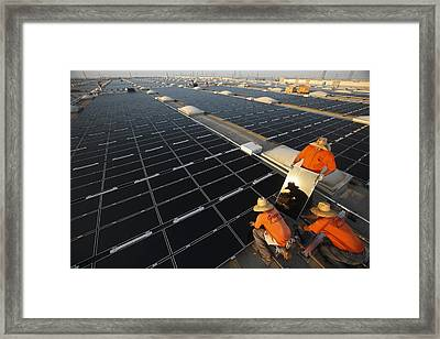 Installing Photovoltaic Panels Framed Print by Michael Melford