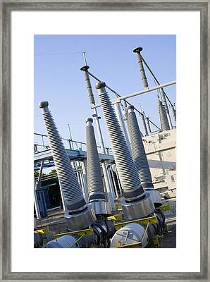Insulators At Electricity Substation Framed Print by Mark Williamson
