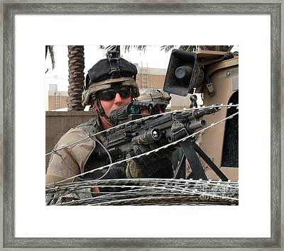 Iraqi And U.s. Soldiers Patrol The Al Framed Print by Stocktrek Images