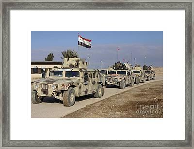 Iraqi Army Soldiers Aboard M1114 Humvee Framed Print