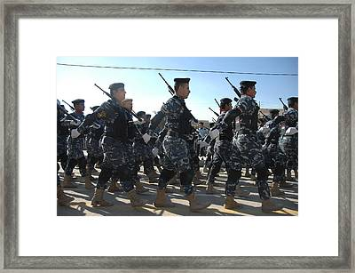 Iraqi Police Officers March Framed Print by Everett