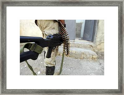 Iraqi Soldiers Carrying Machine Guns Framed Print by Stocktrek Images