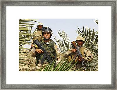 Iraqi Soldiers Conduct A Foot Patrol Framed Print by Stocktrek Images
