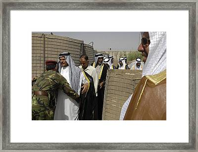 Iraqi Soldiers Search Village Leaders Framed Print by Everett
