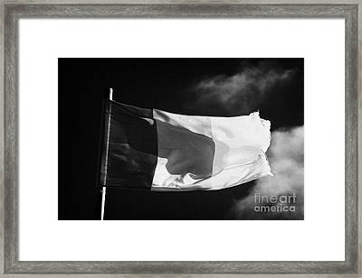 Irish Tricolour Flag With Frayed Edges Flying In Republic Of Ireland Framed Print by Joe Fox