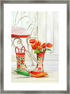 Iron Chair With Little Rain Boots And Tulips  Framed Print by Sandra Cunningham