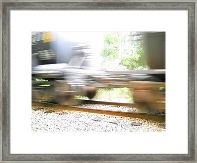 Iron In Motion Framed Print