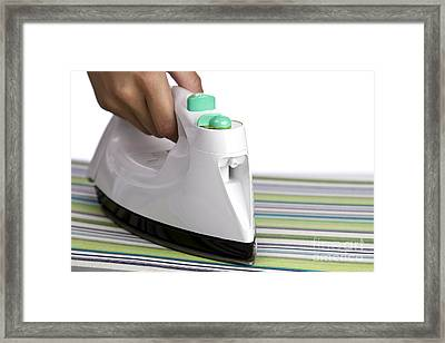 Ironing Framed Print by Blink Images