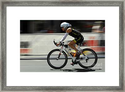 Ironman 2012 Flying By Framed Print by Bob Christopher
