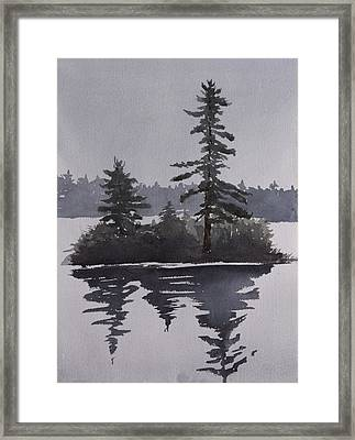 Island Reflecting In A Lake Framed Print by Debbie Homewood