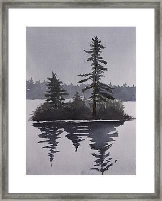 Island Reflecting In A Lake Framed Print by Debbie Homewood
