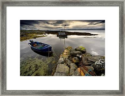 Islay, Scotland Two Boats Anchored By A Framed Print by John Short