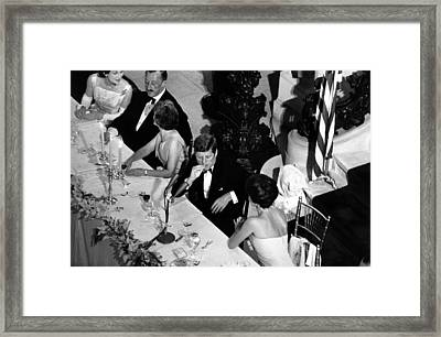 Jacqueline Kennedy Leans Over To Talk Framed Print
