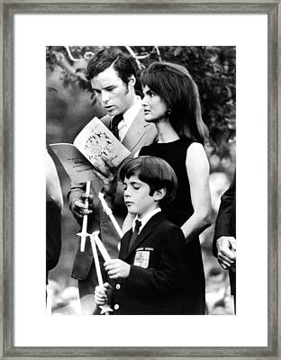 Jacqueline Kennedy Onassis And Her Son Framed Print by Everett