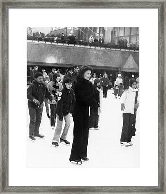 Jacqueline Kennedy Onassis Ice Skating Framed Print by Everett